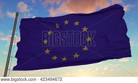 European Union Flag On Flagpole. Flag Of European Union Waving In Wind. 3d Rendering