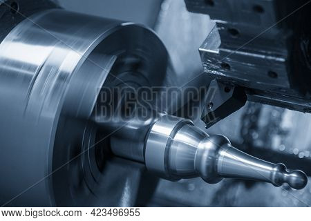The  Cnc Lathe Machine Cutting The Metal Shaft Parts. The Hi-technology Metal Working Processing By