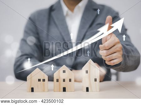 Businessman Showing Thumbs Up Mini And Wood House Model From The Model On Wood Table, Planning Buy R