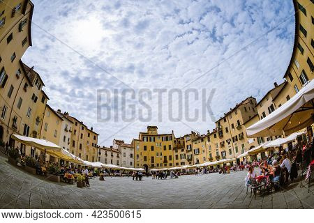Lucca, Italy - May 23, 2021: View Of Piazza Dell'anfiteatro (amphiteater Square) In Lucca, Italy, Ri