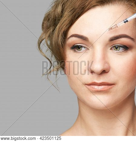 Face Needle Injection. Young Woman Cosmetology Procedure. Doctor Hand In Glove Holds. Pretty Female