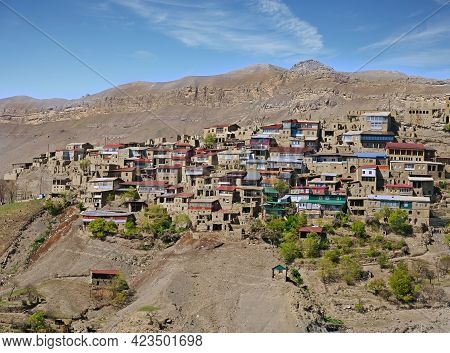 Chokh Town With Old Brick Buildings On Hill Steep Slope Among Fantastic Mountains On Sunny Day In Da