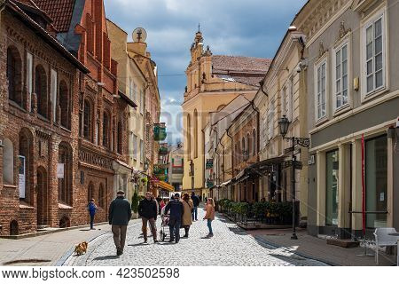 Vilnius, Lithuania - May 8, 2021: Tourists Walk On Pilies Street, The Oldest And Most Flamboyant Str