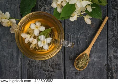 Top View Of A Glass Teapot And A Spoon Of Jasmine Tea. An Invigorating Drink That Is Good For Your H