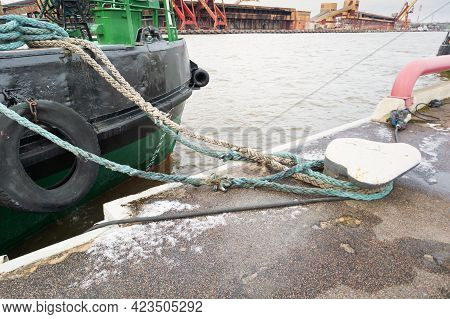 The Ship Is Moored In The Port With Ropes