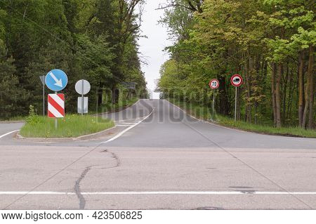 View Of The Road Junction And Road Signs In The Forest.