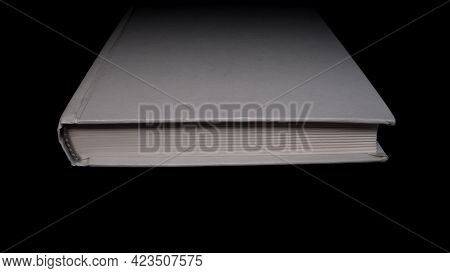 A Book With Blank Covers In The Dark. Close-up.