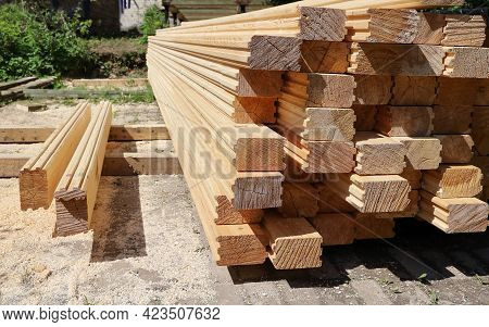 Wooden Timber Calibrated Lumber Stack For Building House, Under Open Sky On Sunny Day