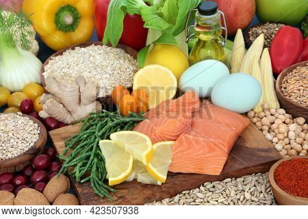Health food for a healthy heart diet with fruit, vegetables, legumes, dairy, olive oil, grains, cereal and seeds, high in protein, omega 3, antioxidants, anthocyanins, vitamins, fibre and smart carbs.