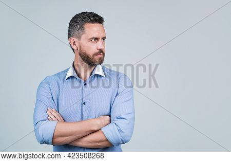 Mature Ambitious Man Businessman In Shirt Has Grizzled Hair Crossed Hands, Copy Space, Advertisement
