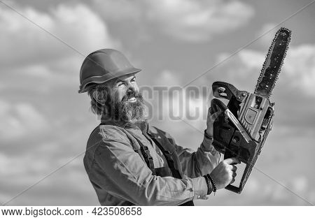 Lets Do It. Engineer Career. Mature Bearded Man In Hard Hat. Man Builder Use Power Saw. Professional