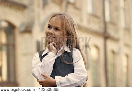 Happy Little Child Lost In Thoughts With Thoughtful Look In School Uniform Outdoors, Thinking