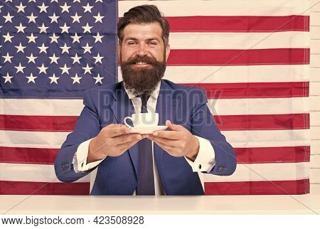 Try This. Drinking Coffee On Tribune. American Politician In Election. His Election Campaign. Bearde