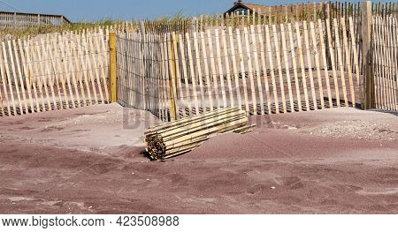 Wooden Picket Fences Being Installed In Front Of Sand Dunes For Protection On The Beaches Of Fire Is