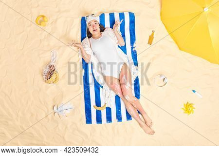 Disappointed Puzzled Woman Looks Worried Burned Skin While Lying In Sun Applies Sunscreen Shrugs Sho
