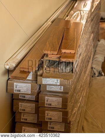 Morgantown, Wv - 6 June 2021: Stack Of Boxes Of Brazilian Cherry Exotic Hardwood Flooring Planks Rea