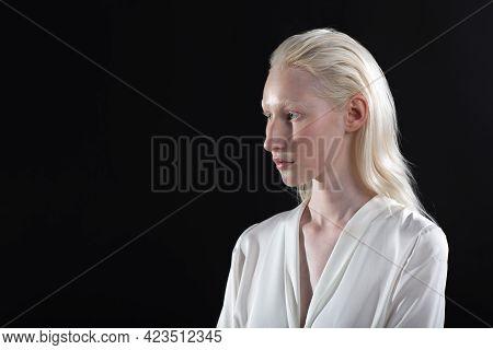 Close Up Profile Portrait Of Caucasian Albino Blonde Woman.
