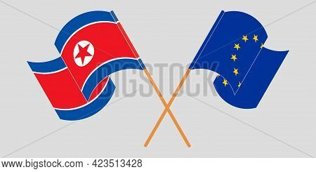 Crossed And Waving Flags Of North Korea And The Eu