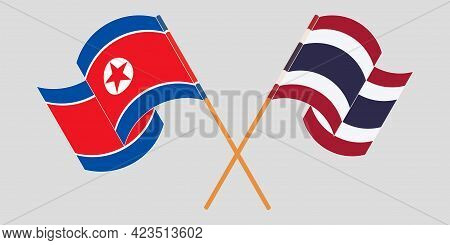 Crossed And Waving Flags Of North Korea And Thailand