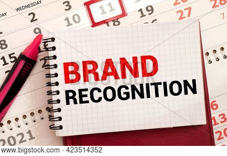 Build Your Brand Inscription On A Sheet And 4 On The Background Of Financial Reporting, Calculator,