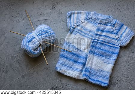Blue White Baby Knitted Handmade Wear With Tangle Of Yarn And Needles