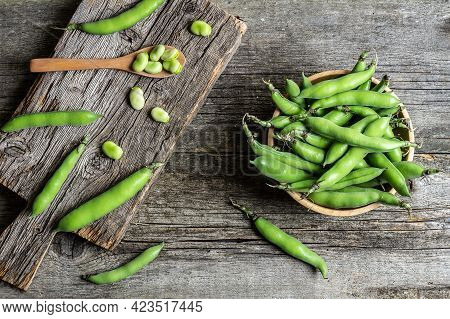 Fresh Broad Beans With Pod On Rustic Background, Healthy Food