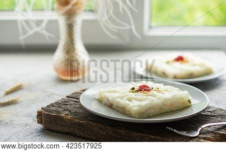Traditional Turkish Ramadan Dessert Gullac, Milky Dessert With Pistachio Powder And Strawberry Jam,