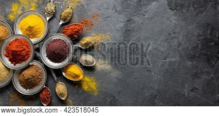 Assortment Of Natural Spices On A Vintage Silver Spoons Or Dishes On Dark Rustic Stone Background, H