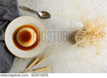 Cream Caramel Pudding With Caramel Sauce In Plate On White Rustic Table
