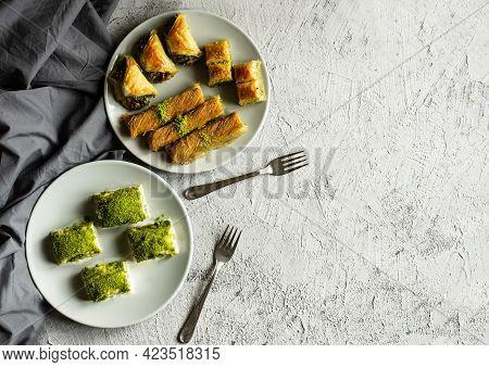 Traditional Turkish Various Pistachio Baklava, Burma Kadayif And Milky Cold Baklava In Plate On Whit
