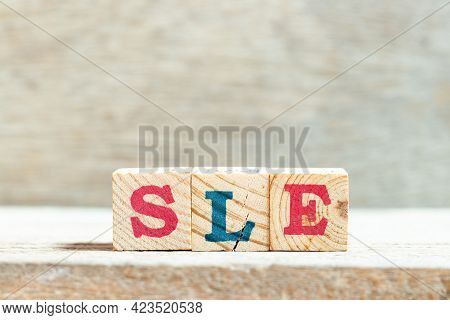 Alphabet Letter Block In Word Sle (abbreviation Of Systemic Lupus Erythematosus) On Wood Background