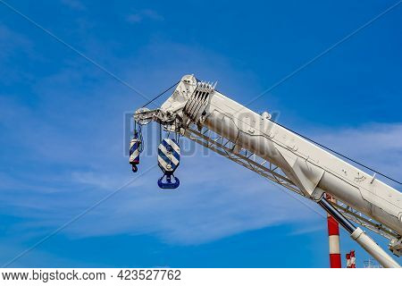 Mobile Crane On The Road And Tower Crane On Construction Site, Crane With Blue Sky Background
