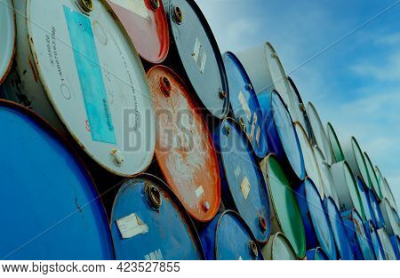 Old Chemical Barrels Stack. Blue And Red Oil Drum. Steel Oil Tank. Toxic Waste Warehouse. Hazard Che