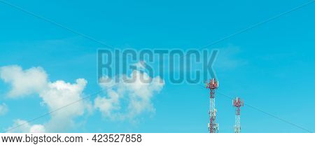 Telecommunication Tower With Blue Sky And White Clouds. Radio And Satellite Pole. Communication Tech
