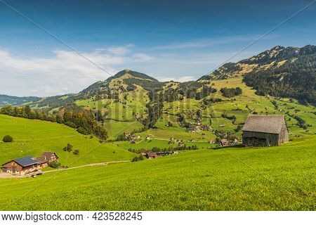 Green Meadows And Pastures, Scattered Settlements And Alpine Huts In The Swiss Alps In Swiss Toggenb