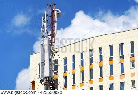 A Cell Tower Near The Residential Building Or Office. Electromagnetic Radiation In The City Backgrou