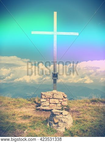 Wooden Summit Cross In The Austrian Alps Mountains. Cloudy Weather.  Abstract.