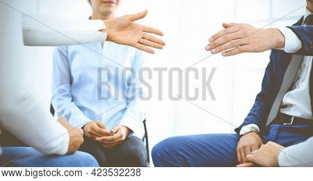 Group Of People Sitting In A Circle During Therapy. Meeting Of Business Team Participating In Traini