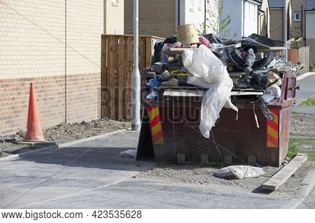 Rubbish And Garbage In Skip For Disposal At Dump Site