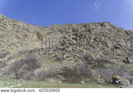 Rocky Cliff With Traces Of Fossilized Coral Deposits. Cape Meganom, Crimea.