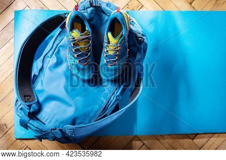 Sports Bag And Sneakers. Blue Duffel Bag And Blue Trainers. Sports Composition.