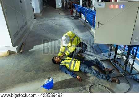 Asian Electrician Worker Accident Electric Shock Unconscious In Site Work. Supervisor First Aid Main