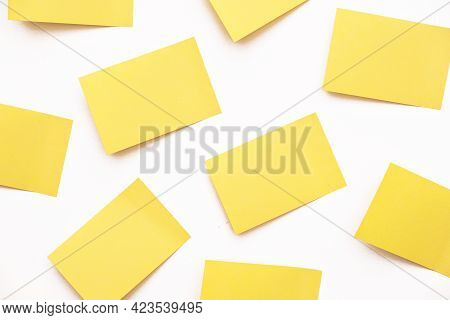 A Group Of Yellow Post-it Notes Memo Sticker Papers Note Pads On The Wall
