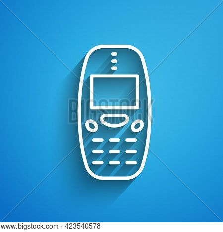 White Line Old Vintage Keypad Mobile Phone Icon Isolated On Blue Background. Retro Cellphone Device.