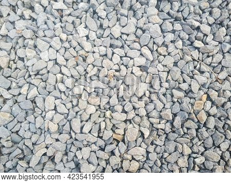 Gravel Stones Flooring Pattern Surface Texture. Close-up Of Exterior Material. Small Road Stone Back