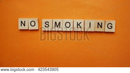 The Words No Smoking On The Background. Words Made Of Wooden Cubes. Smoking Is Prohibited, Prohibite