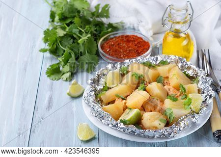 Baked In A Foil Packet Cajun Pineapple Chicken, Garnished With Lime And Cilantro, Horizontal, Copy S