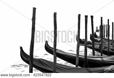 The Gondolas Are At The Pier Covered With Cloth. A Boat Is Sailing In The Distance, Driven By A Gond