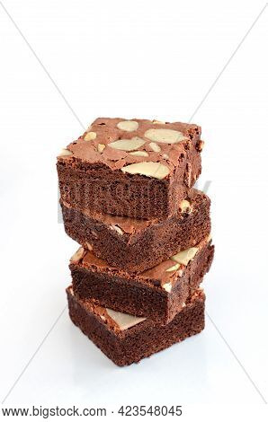 Four Pieces Of Delicious Homemade Brownie Stack On White Background