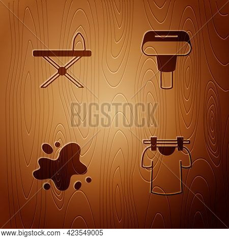 Set Drying Clothes, Iron And Ironing Board, Water Spill And Garment Steamer On Wooden Background. Ve